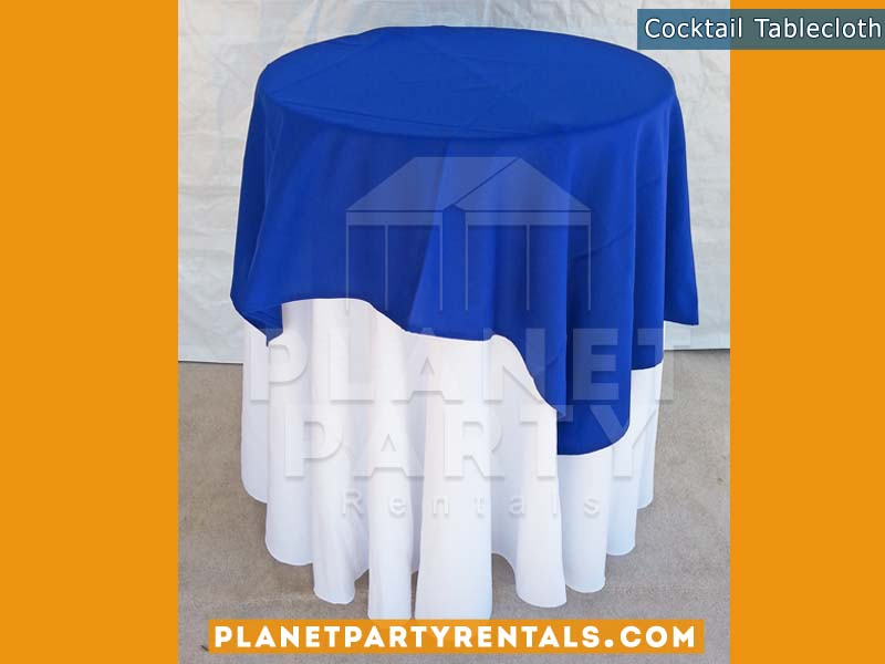 White Round Tablecloth on cocktail table with royal blue overlay |Tablecloth / Linen Rentals