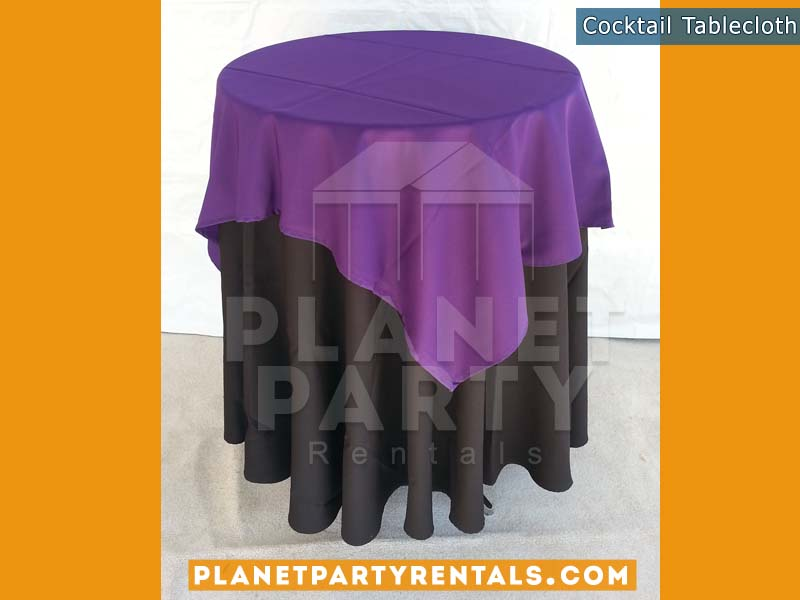 Black Tablecloth on cocktail table with purple overlay | Tablecloth / Linen Rentals
