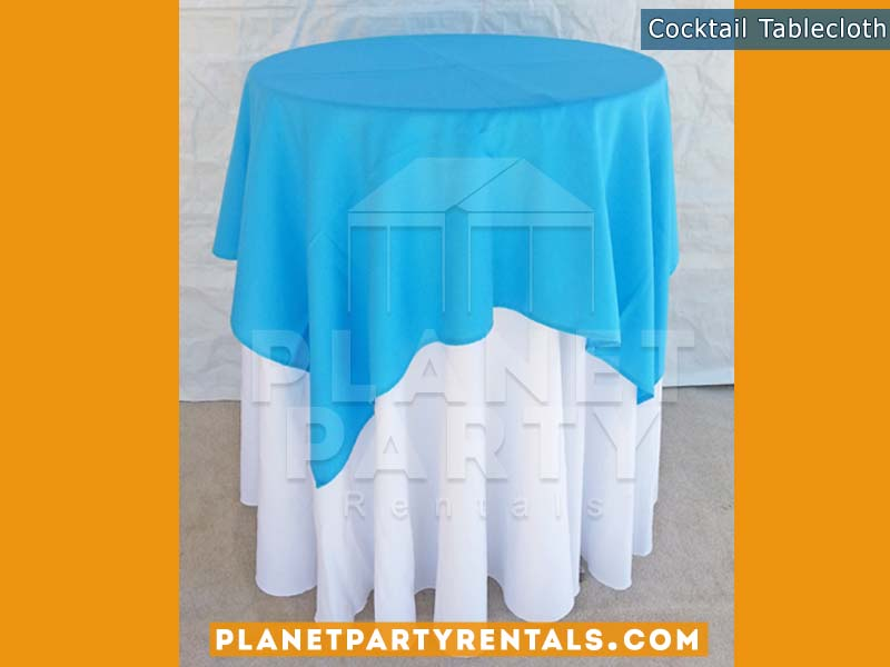 White Round Tablecloth on cocktail table with light blue overlay |Tablecloth / Linen Rentals