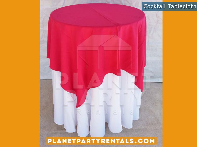 White Round Tablecloth on cocktail table with fuchsia overlay |Tablecloth / Linen Rentals