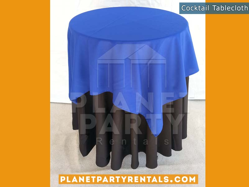 Black Tablecloth on cocktail table with royal blue overlay | Tablecloth / Linen Rentals