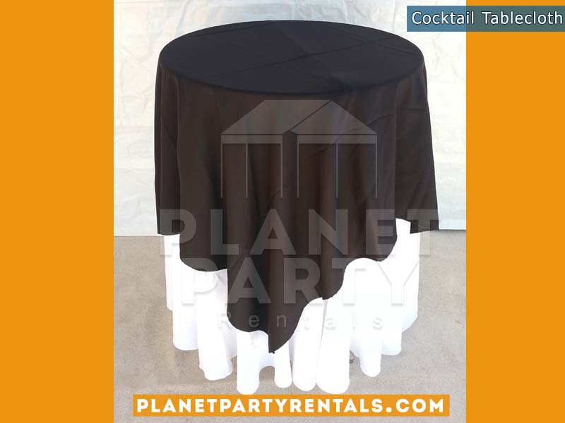 White Round Tablecloth on cocktail table with black overlay |Tablecloth / Linen Rentals