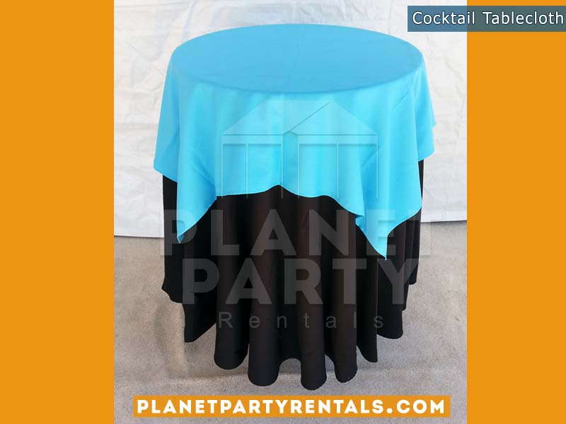 Black Tablecloth on cocktail table with light blue overlay | Tablecloth / Linen Rentals