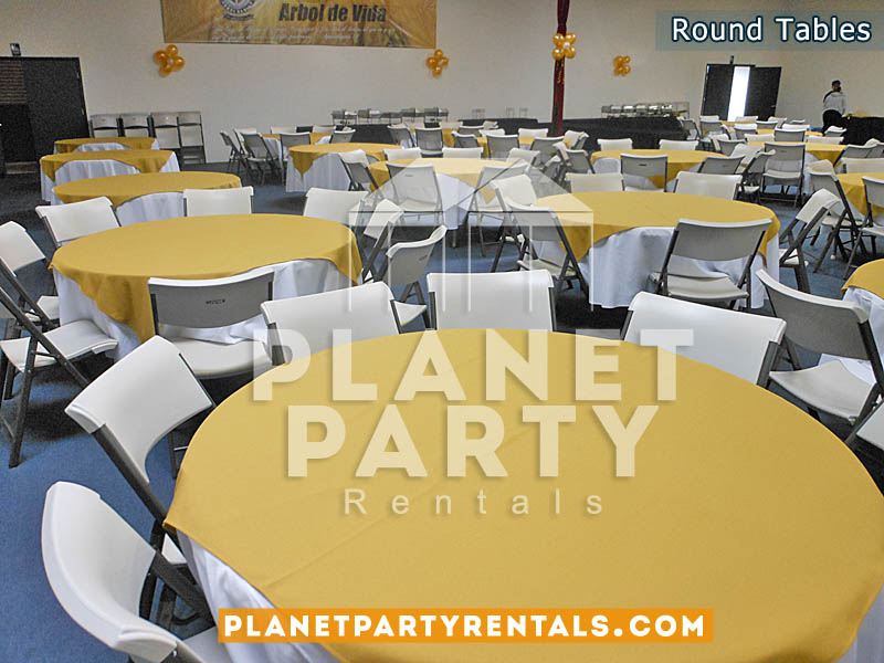 "60"" Round plastic table with white tablecloths and yellow overlay with white chairs"