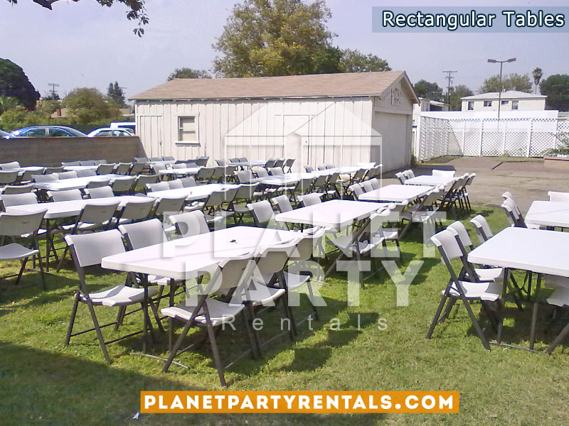 White plastic chairs with 6ft x 3ft rectangular tables