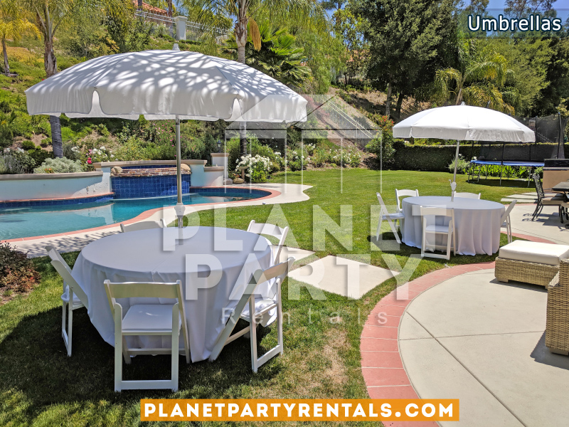 "White Umbrella with 60"" Round Tables and White Tablecloth and White Plastic Chairs"