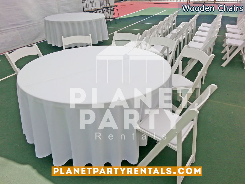 White Wooden Folding Chairs with Padded Seats and Round Table with White Round Tablecloth