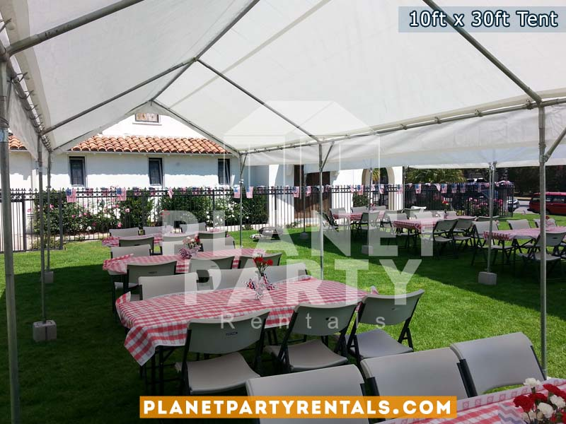 10ft x 30ft tents on grass | Tent Packages available for rent includes tables and chairs | San Fernando Valley Tent Rental Equipment
