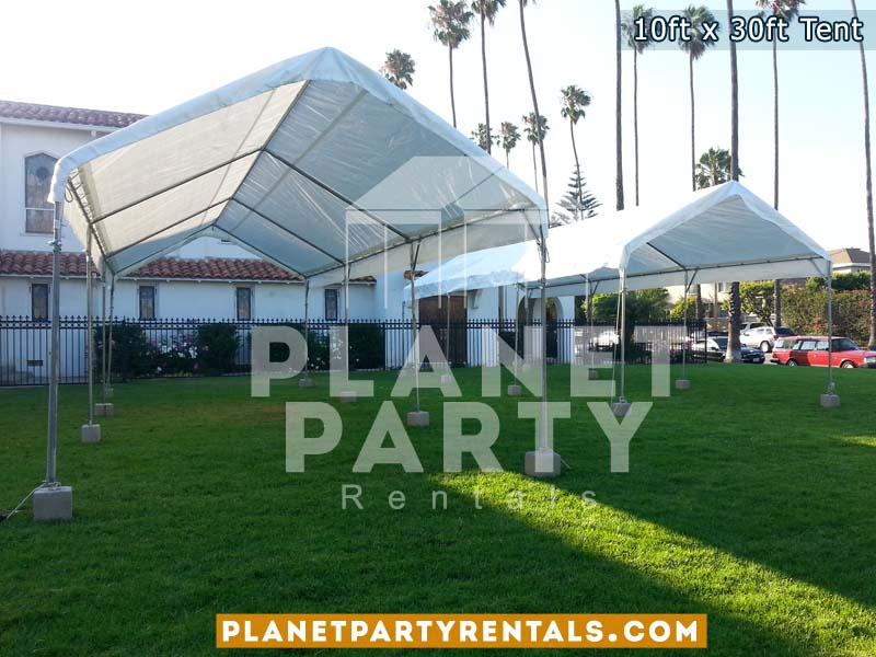 10ft x 30ft tents on grass | Tent Packages available for rent includes tables and chairs & 10ft x 30ft Tent Rental