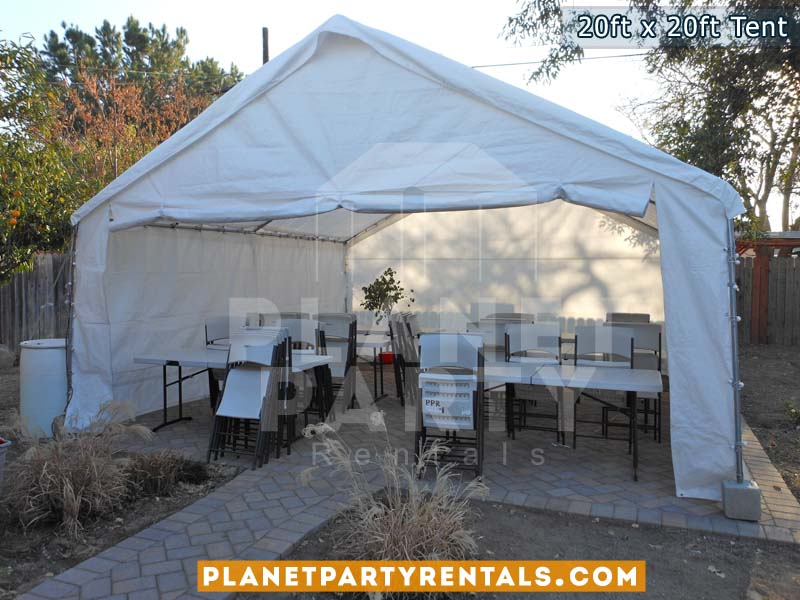 20ft x 20ft Tent with Sidewalls with tables and chairs | San Fernando Valley Tent Rentals