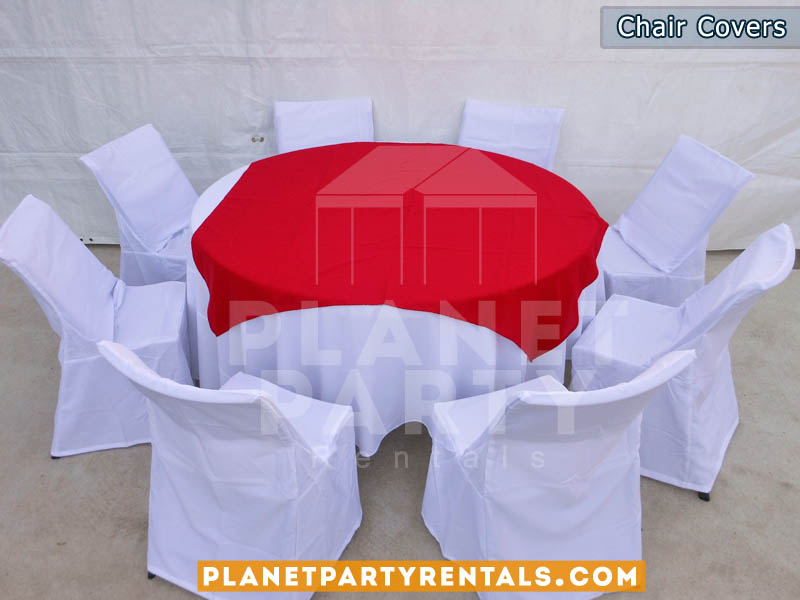 white chair covers with rectangular table and red diamond/runner
