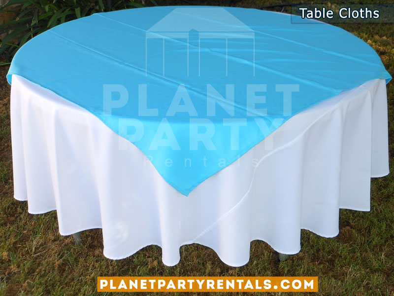 Round White Table Cloth On Round Table With Light Blue