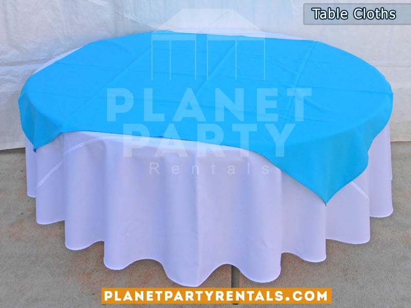 Round White Table Cloth On Round Table With Blue Diamond