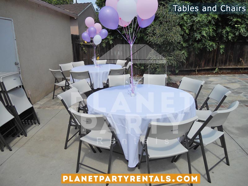 White plastic chairs with round table with white table cloth