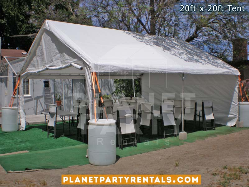 20x20 Tent with rectangular tables and white plastic chairs
