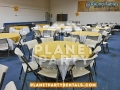 004-round-table-with-white-tablecloth-and-yellow-overlay-with-chairs
